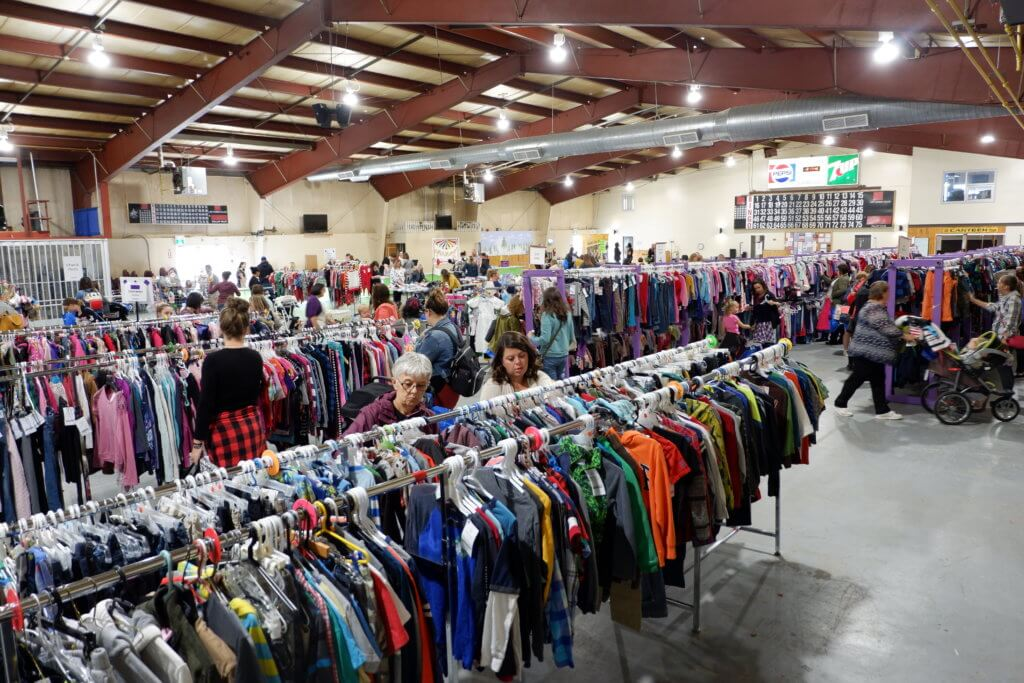 racks of gently loved used clothing for sale
